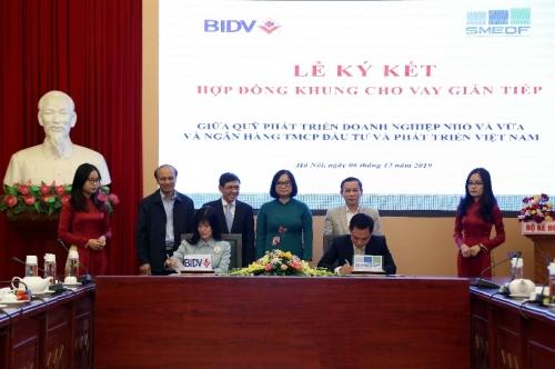 Ký Hợp đồng khung cho vay gián tiếp giữa Quỹ Phát triển DNNVV và BIDV