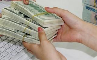 Các ngân hàng đồng loạt giảm giá USD sau động thái trấn an của NHNN