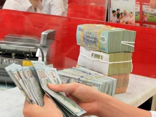 NHNN tiếp tục giảm giá mua vào USD và giảm tỷ giá trung tâm