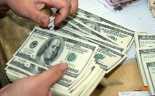 Tỷ giá trung tâm tăng mạnh, giá USD ngân hàng tiếp tục ổn định