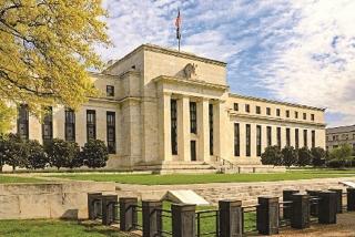 Fed để ngỏ khả năng tăng quy mô nới lỏng định lượng