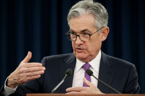 Việc giữ lãi suất của Fed 'lu mờ' trước căng thẳng thương mại gia tăng