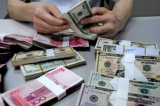 Căng thẳng thương mại leo thang, nhân dân tệ vượt 7 CNY/USD, mức thấp kỷ lục