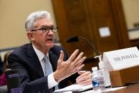 Fed phát tín hiệu sớm giảm mua trái phiếu, tăng lãi suất vào năm tới