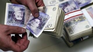 Đồng bảng Anh giảm khi BOE chia rẽ quan điểm về lãi suất