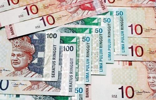 Malaysia đau đầu với bài toán tỷ giá