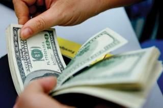 Tỷ giá trung tâm và tỷ giá tại các ngân hàng đi ngang