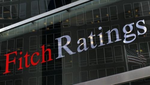 Fitch giảm triển vọng kinh tế toàn cầu